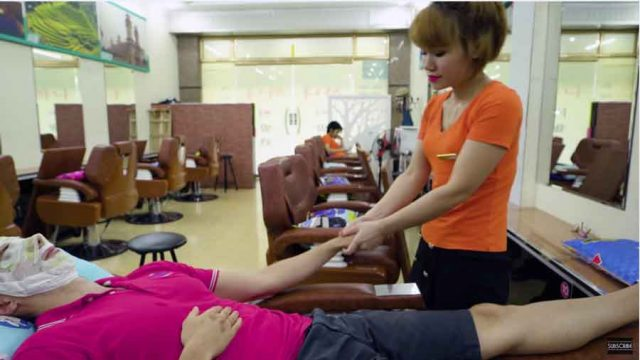 Arms and hands massage by Vietnamese massage therapist